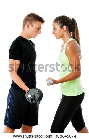 Close up portrait of Teen couple having fitness challenge.Face to face side view of couple with serious facial expressions.Isolated on white background.