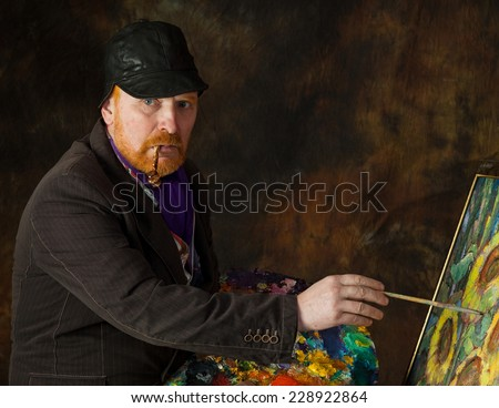 close-up portrait of the adult artist with red beard and mustache  - stock photo