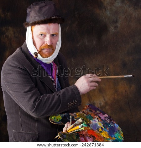 close-up portrait of the adult artist with red beard and mustache studio on dark background - stock photo
