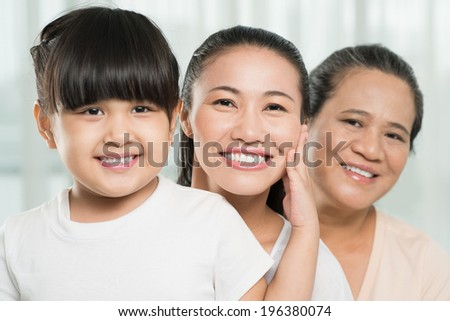 Close-up portrait of three female generations in the family - stock photo