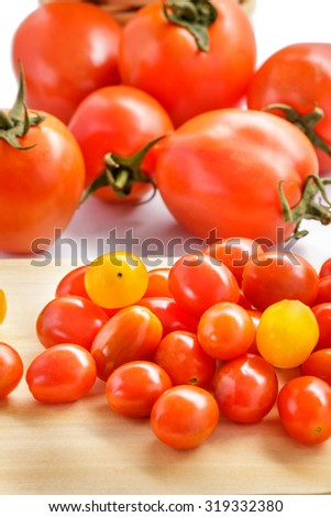 close up portrait of tomatoes and cherry tomatoes