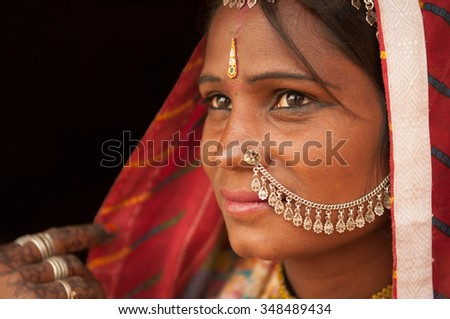 Close up portrait of traditional Indian woman in sari dress thinking, India people.
