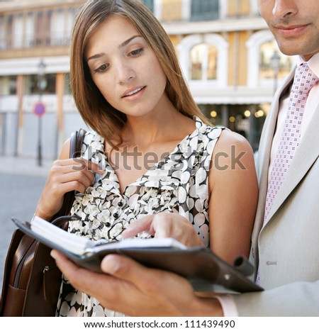 Close up portrait of two business people having a meeting in a classic city center. - stock photo