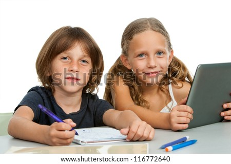 Close up portrait of two young students at study desk.Isolated on white.