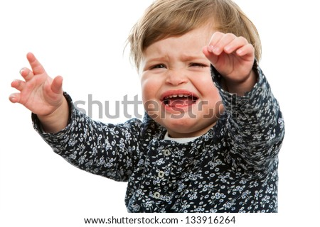 Close up portrait of unhappy toddler crying for attention. - stock photo