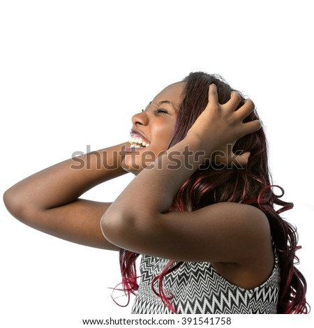 Close up portrait of upset screaming african teen girl with hands in hair.Isolated on white background. - stock photo