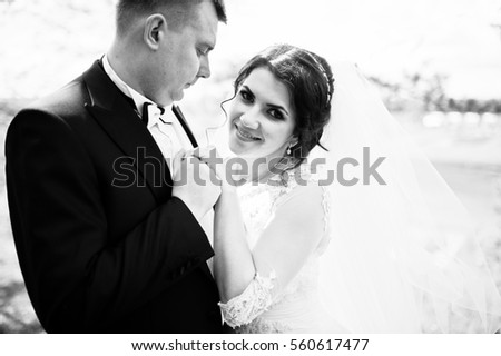 Close up portrait of wedding couple in love. Black and white photo