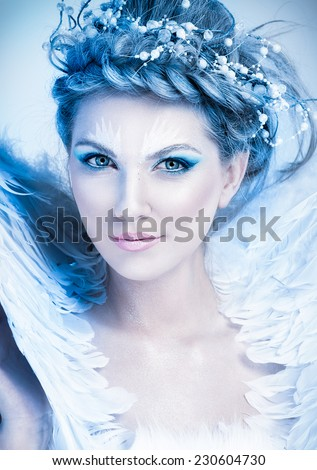 Close up portrait of winter queen with artistic make-up - stock photo