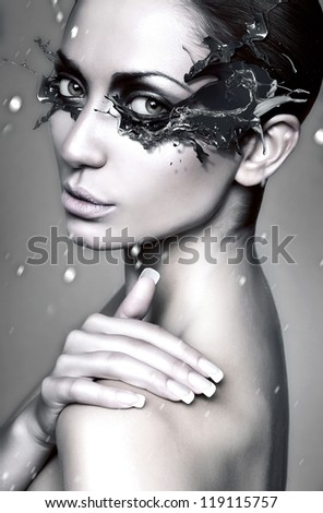 close up portrait of winter woman with blue splash mask