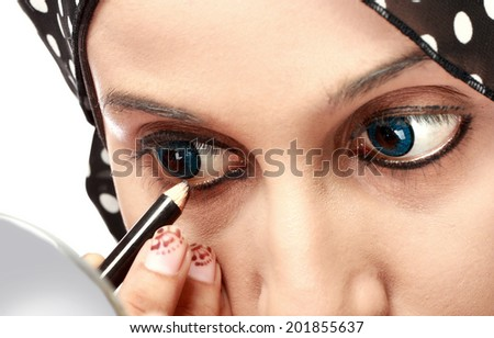 close up portrait of Woman Applying Eyeliner