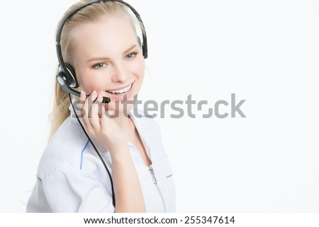 Close up portrait of Woman customer service worker, call center smiling operator with phone headset - stock photo