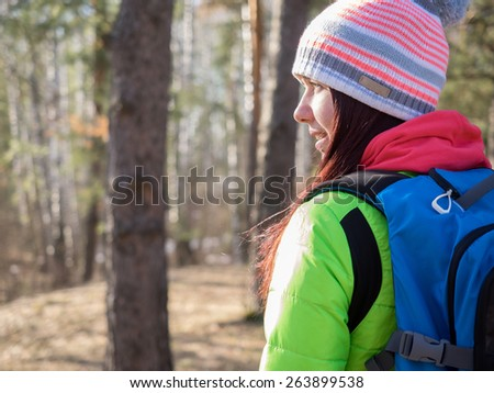 Close up portrait of woman hiking in the forest - stock photo