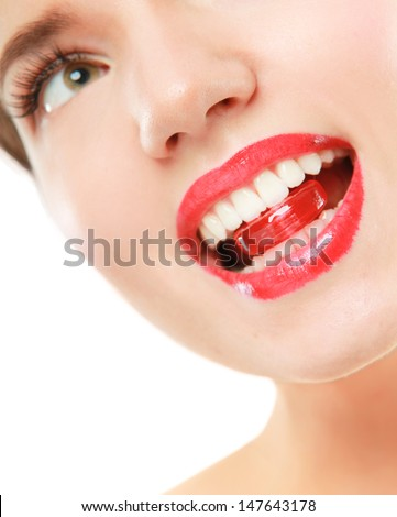 close up portrait of woman, holding candy in mouth - stock photo