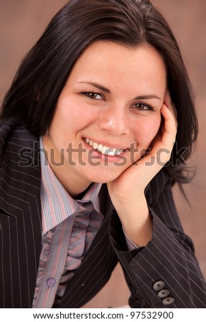 close-up portrait of woman in business suit - stock photo