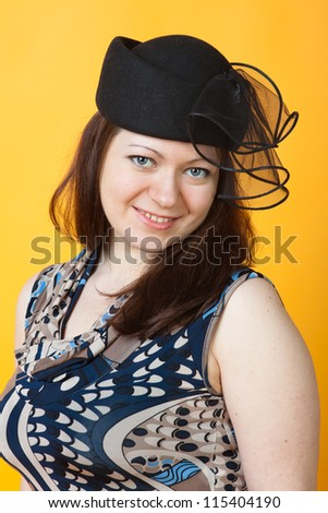 close-up portrait of woman in hat - stock photo