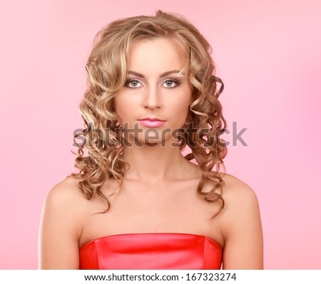 Close-up portrait of woman, isolated on pink background
