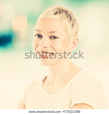 Close up portrait of woman looking at camera and smiling, instagram style filter