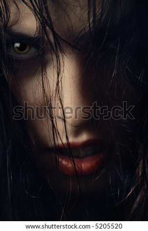 Close-up portrait of woman-witch with wet hairs - stock photo