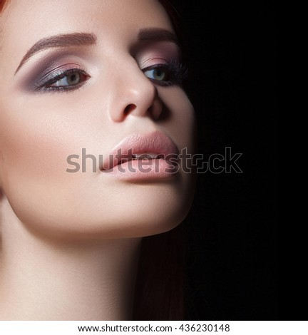 Close-up portrait of woman with beautiful face - isolated on black. Skin care concept. - stock photo