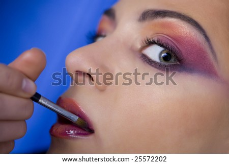 close up portrait of woman with colored make up - stock photo