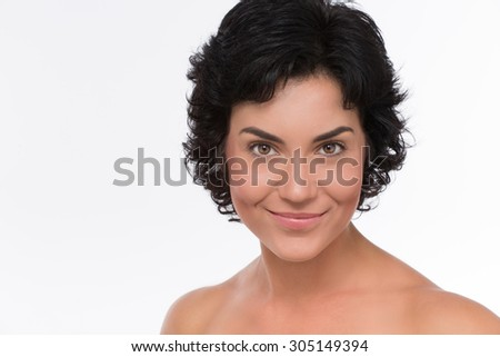 Close-up portrait of woman with eyes like gimlet isolated on white. Mature beautiful adult brunette woman with clean face. High key shot. - stock photo