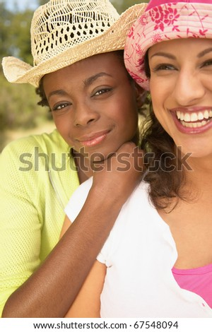 Close up portrait of women laughing - stock photo