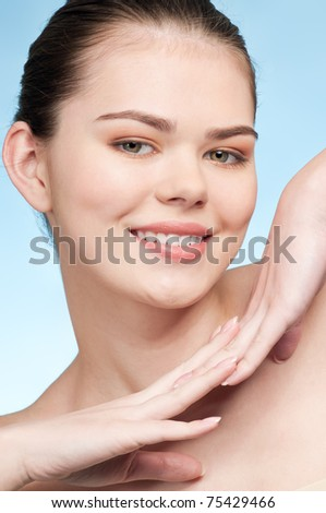 Close-up portrait of young adult woman with perfect health skin of face