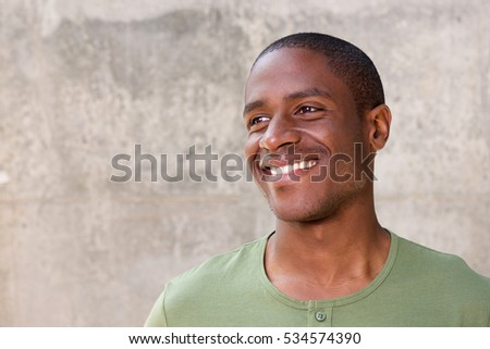 Close up portrait of young african american man on gray background smiling