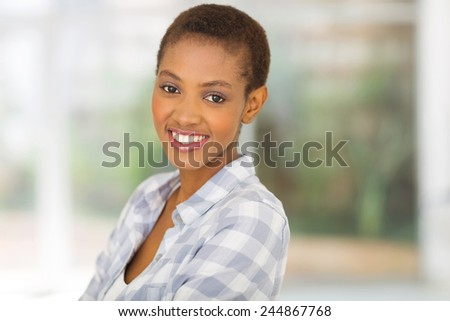 close up portrait of young african american woman at home - stock photo