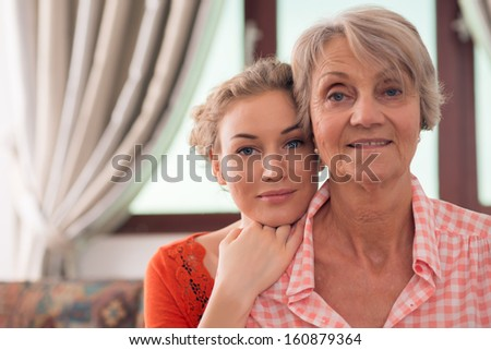 Close-up portrait of young and elderly women of the same family - stock photo