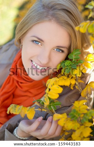 close up portrait of young attractive dreaming girl in autumn park