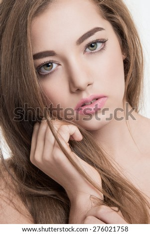 Close-up portrait of young, beautiful and healthy woman with arrows on her face - stock photo