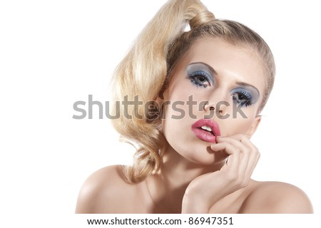 Close-up portrait of young beautiful blond woman with hair tail stylish and creative make up posing towards the camera against white background - stock photo