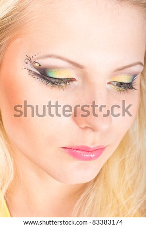 Close-up portrait of young beautiful blonde woman with stylish make-up