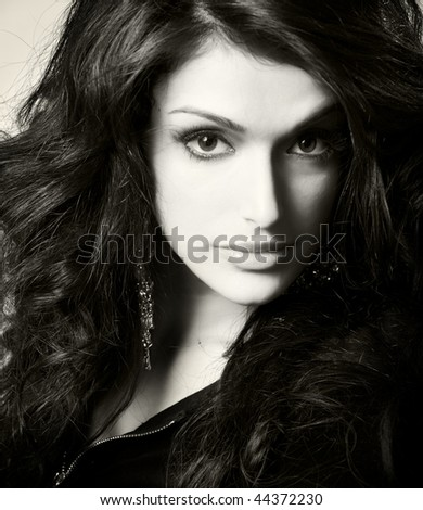 close up portrait of young beautiful brunette, studio shot - stock photo