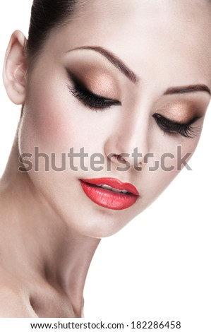 Close-up portrait of young beautiful girl with professional Make-up.Beautiful Face. Makeover. Perfect Skin. Isolated on a white background.