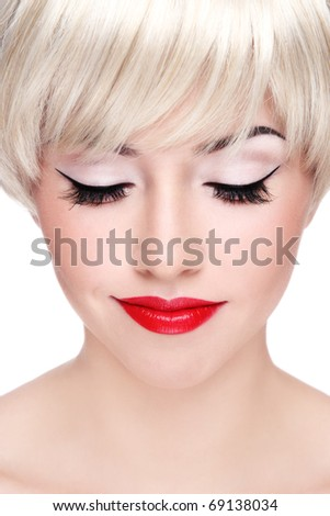 Close-up portrait of young beautiful smiling woman with red lips - stock photo