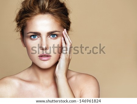 Close-up portrait of young beautiful woman  - stock photo