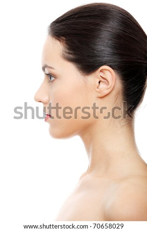 Close-up portrait of young beautiful woman face on white background