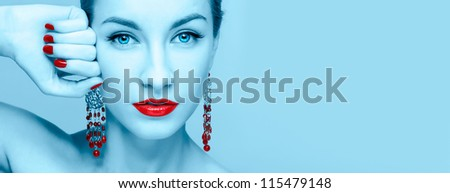 Close-up portrait of young beautiful woman in blue and red style with copy space - stock photo