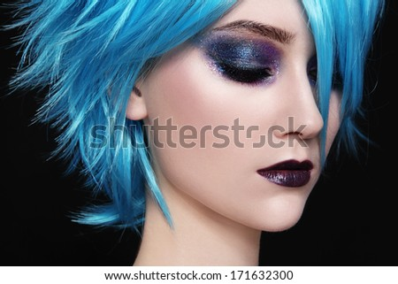 Close-up portrait of young beautiful woman in blue cosplay wig - stock photo