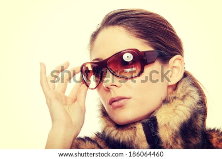 Close up portrait of young beautiful woman in fur - stock photo