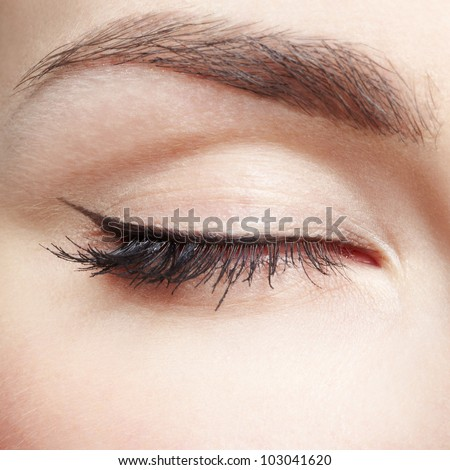 close-up portrait of young beautiful woman's eye zone make up - stock photo