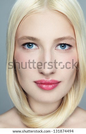Close-up portrait of young beautiful woman with bleached hair - stock photo
