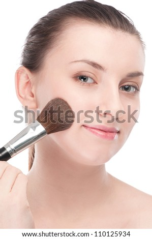 Close-up portrait of young beautiful woman with brush for make-up. Cheek zone - stock photo