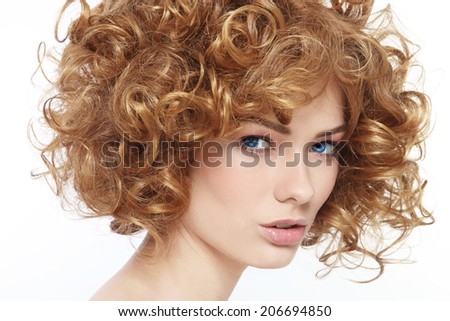 Close-up portrait of young beautiful woman with curly hair - stock photo