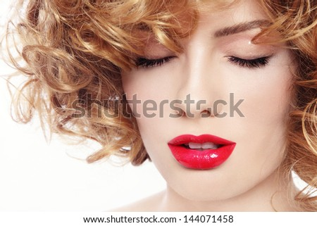 Close-up portrait of young beautiful woman with curly hair and red lipstick - stock photo