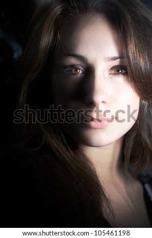 Close up portrait of young beautiful woman with expressive eyes and dark hair - stock photo