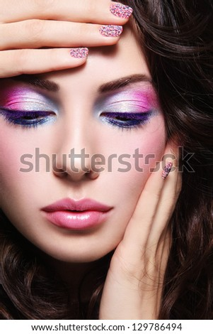 Close-up portrait of young beautiful woman with fancy make-up and caviar manicure - stock photo