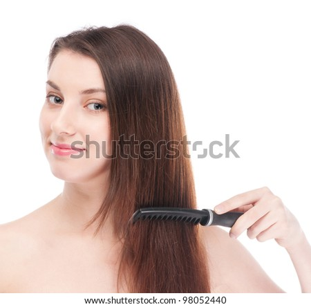 Close-up portrait of young beautiful woman with hair brush
